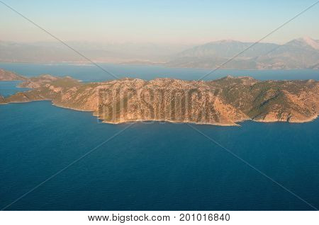 Landscape of mountains and the sea, top view.