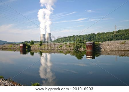steam rises from the cooling towers of Watts Bar nuclear reactor