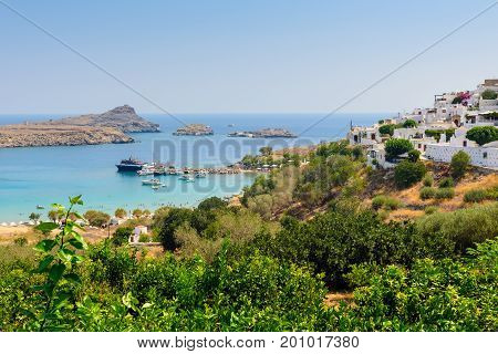 Aerial view on panorama of Lindos town with beautiful lagoon near it