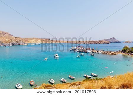 Traditional greek boats at beautiful lagoon near Lindos town on Rhodes island, Greece