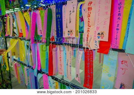 Wish write on small colorful papers in wishing tree at Little Tokyo, famous attraction place for traveler enjoying Japanese culture located in the streets of Tokyo.