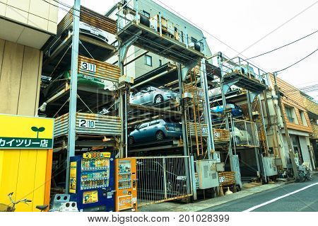 TOKYO, JAPAN -28 JUN 2017: An automated multi-story car parking system. Automatic multi-story car park systems enable to optimize space in crowded cities in Tokyo, Japan.