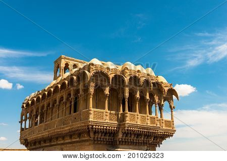 The top of Saalam Singh Ki Haweli carved yellow sandstone architecture in Jaisalmer known as Golden City in India.
