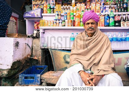 JAISALMER RAJASTHAN INDIA - MARCH 07 2016: Horizontal picture of indian men wearing traditional Rajasthani clothe with colorful turban in Jaisalmer known as Golden City in India.