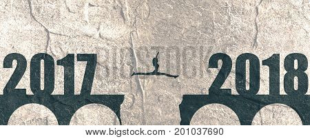 A woman jump between 2017 and 2018 years. Human silhouette jumping over a gap in the bridge. Grunge distress texture