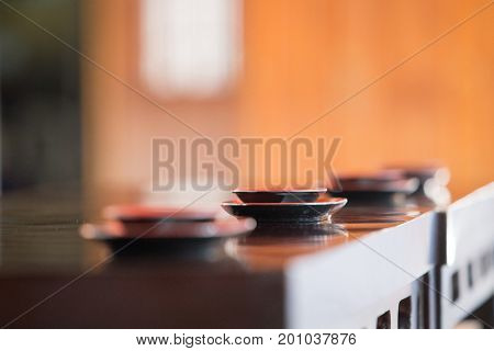 Sake cup on table for drink sake ceremony in japanese buddhist nichiren or shinto wedding ceremony