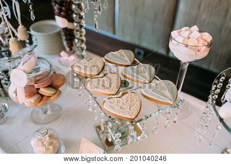 Candy Bar. Delicious Sweet Buffet With Cupcakes And Heart-shaped Biscuit, Chocolates, And Strawberry