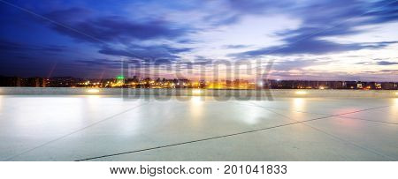 empty floor with cityscape of hangzhou in blue cloud sky at twilight