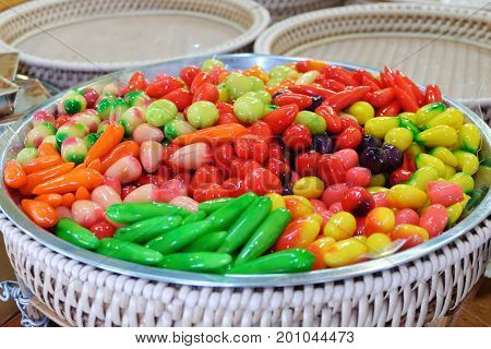 DELECTABLE IMITATION FRUITS: a dessert of Thailand soybean crushing sugar and jelly in fruit shape mold coated with a gel called Thailand is Name