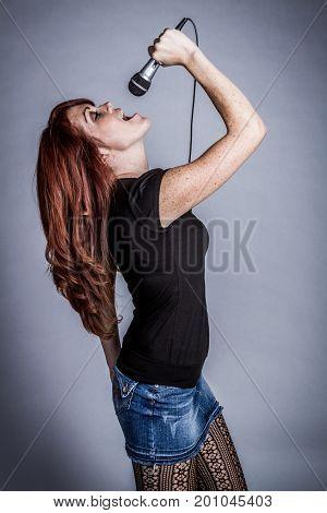 Beautiful singing redhead rockstar woman