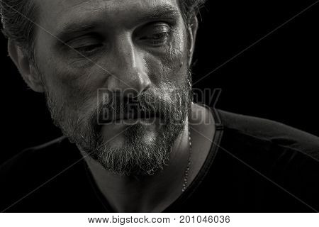 Close up portrait of mid aged man concerned about life difficulties. Mid aged crisis concept, man struggling troubles.