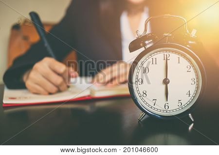 Business Working Time Concept. Morning 6 O'clock With Work People On Background
