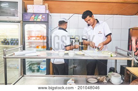 Dhaka, bangladesh, august 2017- a group of waiter working at resturent for preparing food located at bonani resudential area taken on 17, august 2017