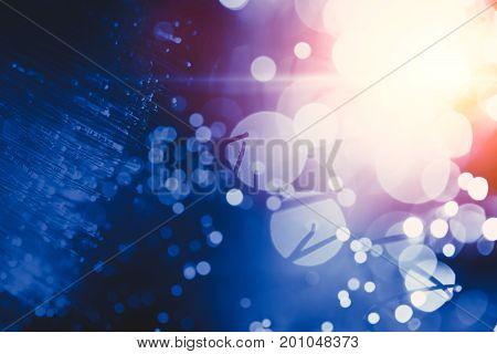 Blur light bokeh of optical fiber innovation data transfer technology blue color tone
