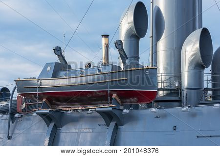 Boat with steam engine aboard the old military cruiser close-up