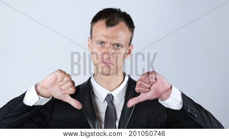Businessman Making Thumbs Down Gesture With Both Hands