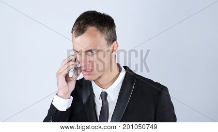 Angry Businessman on the phone, White Background