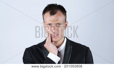 Toothache. Frustrated Young Man Touching His Cheek , White Background