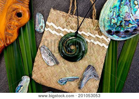 New Zealand - Maori Themed Objects - Jade Pendant With Wooden Mere On Woven Kite Flax Bag