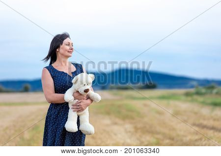 Portrait Of Senior Woman With Teddy Bear