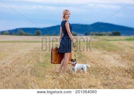 Portrait Of Senior Woman With Suitcase