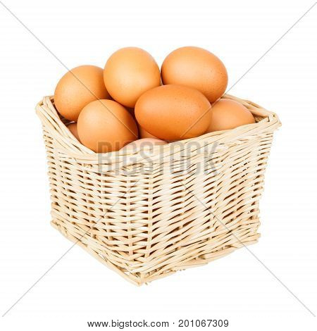 Wicker basket full of eggs isolated on white background close-up
