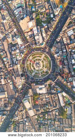 Road roundabout with car lots Wongwian Yai in Bangkok Thailand. street large beautiful downtown at evening light. Aerial view Top view cityscape Rush hour traffic jam