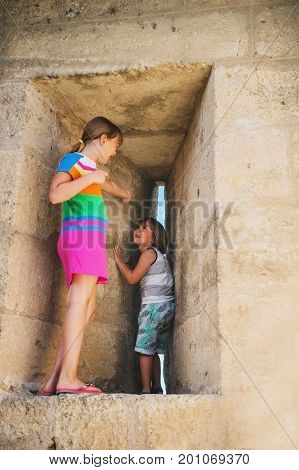 Kids playing in fortress during summer vacation in Aigues-Mortes Camargue France