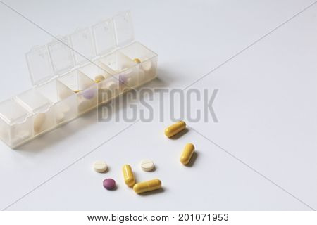 Tablets And Pills Are Spread Out Into A Container For Tablets On The Days Of The Week. Medicines Of