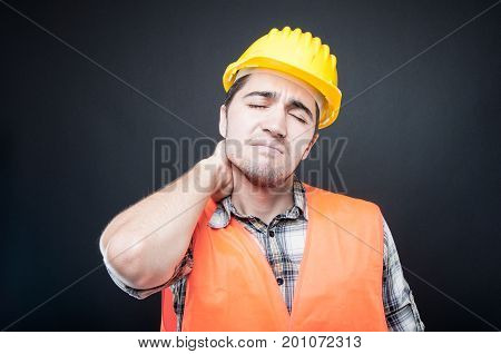 Portrait Of Constructor Holding Neck Like Hurting