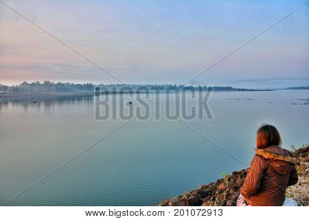 In the morning, the weather is very good. The woman is looking dam beautiful Mimi nampoong views.