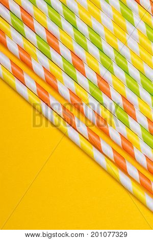 close-up colorful fancy drinking straws fancy tube for party on the yellow background