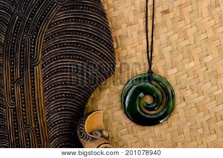 New Zealand - Maori Themed Objects - Mere And Greenstone Pendant On Woven Kite Flax Background