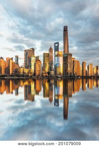 Shanghai skylinelandmarks of Shanghai with Huangpu river at sunrise/sunset in China.