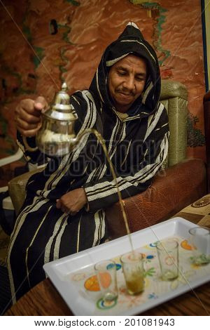 Man In Traditional Clothes Preparing Mint Tea, Morocco