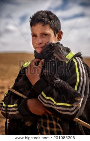 Nomad Boy With The Young Goat, Nomad Valley, Atlas Mountains, Morocco