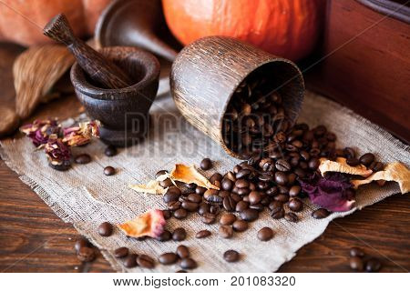 Cup Of Coffee With Beans And Grinder.