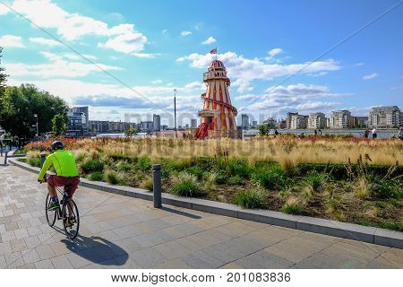 Greenwich London UK - August 10 2017: Greenwich near Cutty Sark with helter skelter. Cyclist in the foreground.