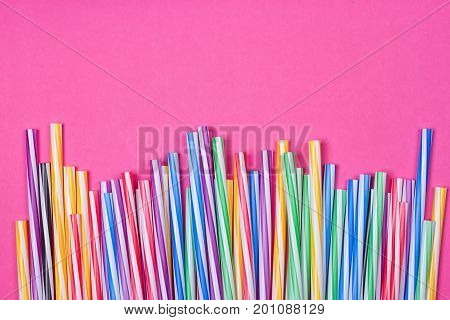 close-up colorful fancy drinking straws fancy tube for party on the pink background