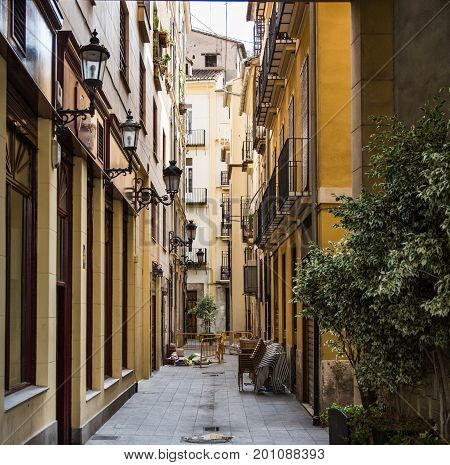 A Narrow Cobblestone Alley in Valencia Spain