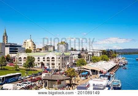 VALDIVIA CHILE - OCTOBER 30 2016: Pier and fish market at riverside of Calle-Calle river. This is the main view of Valdivia.