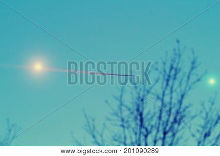 Venus and Moon with de-focused tree silhouette.