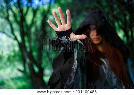 Photo of witch in cloak
