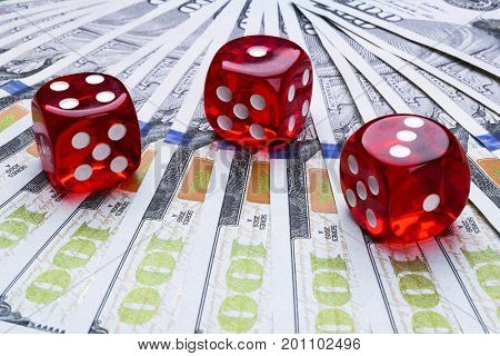 Poker dice rolls on a dollar bills Money. Poker table at the casino. Poker game concept. Playing a game with dice. Casino dice rolls. Concept for business risk. chance good luck