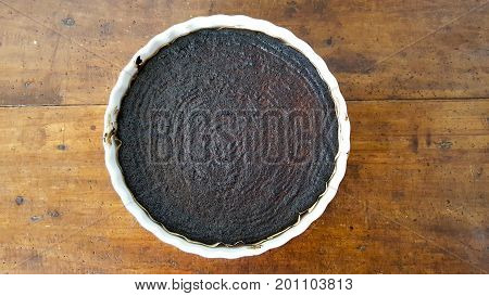 a cake completely burned in the oven