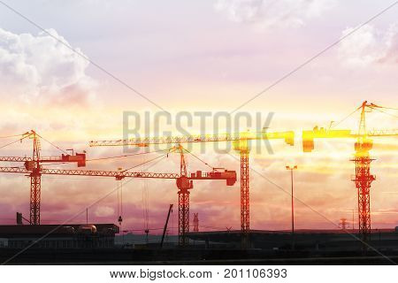 The abstract scene of silhouette construction crane with the sunset scene .Heavy construction concept.