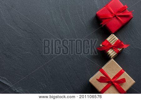 beautiful wraped gift boxes on black background