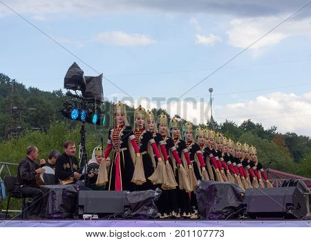 Adygea Russia - August 19 2017: musicians and female composition of the State academic ensemble of folk dance of Adygeya Nalmes at the festival of Circassian cheese