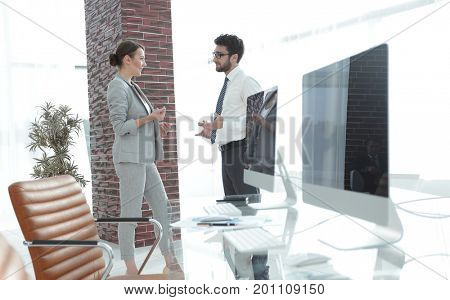 employees are talking in modern office