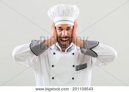 Image of chef is in panic standing on gray background.
